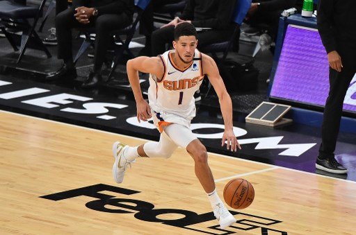 Devin Booker #1 of the Phoenix Suns brings the ball up court. Justin Ford/Getty Images/AFP
