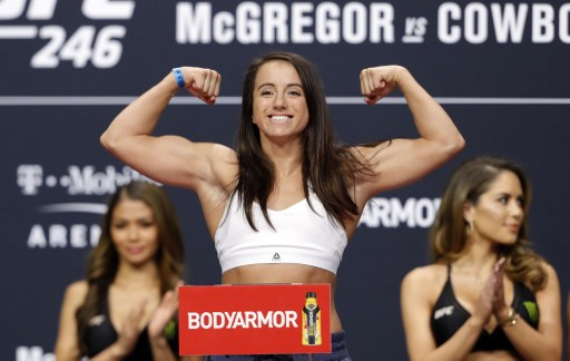 Flyweight fighter Maycee Barber poses on the scale during a ceremonial weigh-in. Steve Marcus/Getty Images/AFP