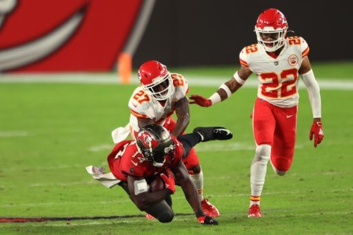 Chris Godwin #14 of the Tampa Bay Buccaneers is tackled by defenders of the Kansas City Chiefs on November 29, 2020. Mike Ehrmann/Getty Images/AFP