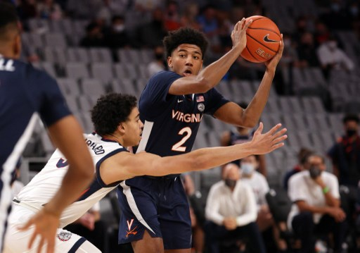 Reece Beekman #2 of the Virginia Cavaliers passes the ball. Ronald Martinez/Getty Images/AFP