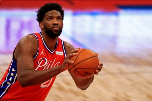 Joel Embiid #21 of the Philadelphia 76ers shoots a free throw. Mike Ehrmann/Getty Images/AFP