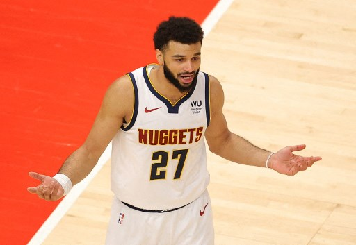 Jamal Murray #27 of the Denver Nuggets reacts. Kevin C. Cox/Getty Images/AFP