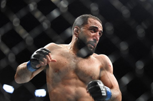 Muhammad fights Curtis Millender during the UFC 236 event