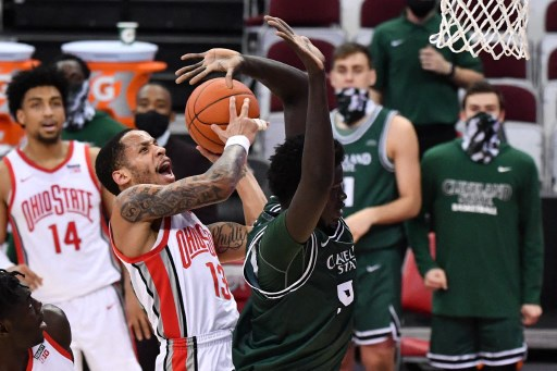 CJ Walker #13 of the Ohio State Buckeyes is fouled by D'Moi Hodge #55 of the Cleveland State Vikings. Jamie Sabau/Getty Images/AFP