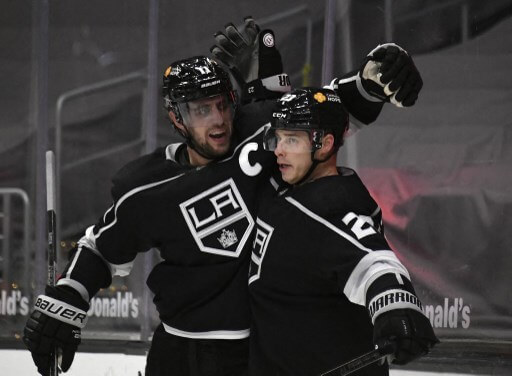Dustin Brown #23 of the Los Angeles Kings celebrates his goal with Anze Kopitar #11 during the second period against the San Jose Sharks at Staples Center on February 9, 2021 in Los Angeles, California. Kevork Djansezian/Getty Images/AFP