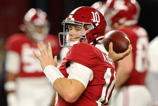 Mac Jones #10 of the Alabama Crimson Tide warms up. Kevin C. Cox/Getty Images/AFP