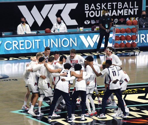 The Gonzaga Bulldogs huddle on the court. Ethan Miller/Getty Images/AFP