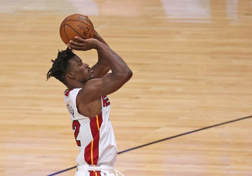 Jimmy Butler #22 of the Miami Heat shots. Jonathan Daniel/Getty Images/AFP