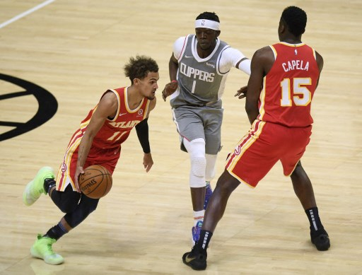 Trae Young #11 of the Atlanta Hawks uses Clint Capela #15 as for a screen. Harry How/Getty Images/AFP