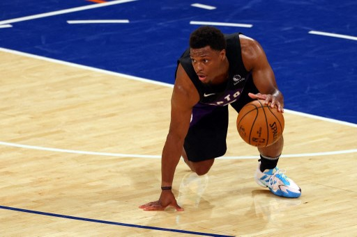 Kyle Lowry #7 of the Toronto Raptors slips as he brings the ball up court. Rich Schultz/Getty Images/AFP