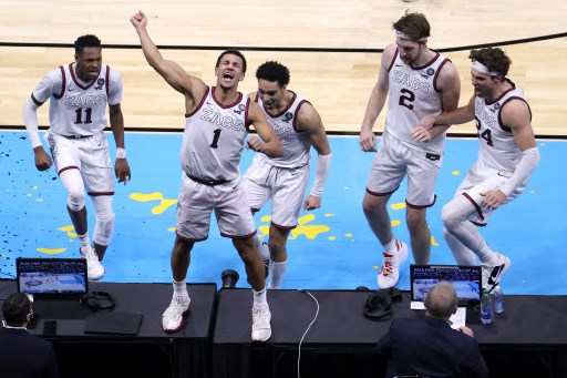 Jalen Suggs #1 of the Gonzaga Bulldogs celebrates with teammates after making a game-winning three point basket. Andy Lyons/Getty Images/AFP
