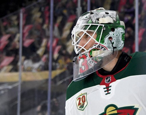 Cam Talbot #33 of the Minnesota Wild takes a break during a stop in play. Ethan Miller/Getty Images/AFP
