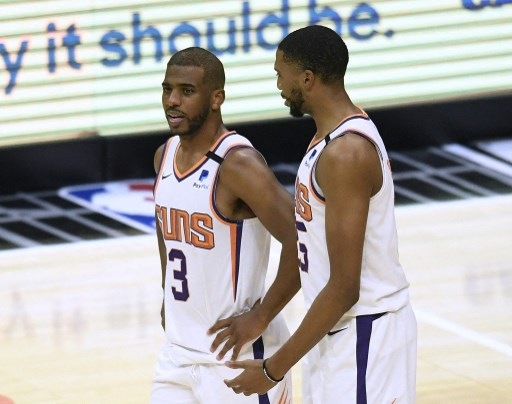 Chris Paul #3 of the Phoenix Suns and Mikal Bridges #25 talk. Harry How/Getty Images/AFP