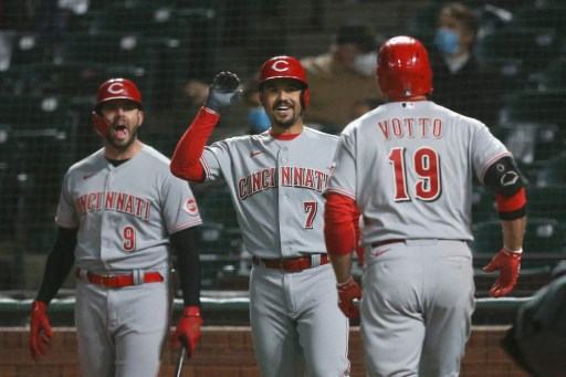 Joey Votto #19 of the Cincinnati Reds celebrates.  Lachlan Cunningham/Getty Images/AFP