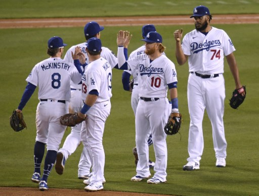 Justin Turner #10 and Kenley Jansen #74 of the Los Angeles Dodgers celebrate.Harry How/Getty Images/AFP
