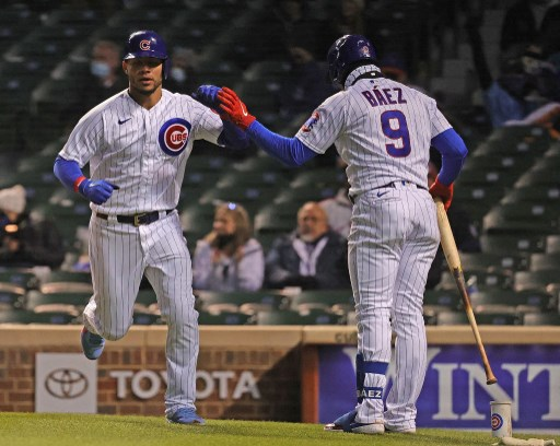 Willson Contreras #40 of the Chicago Cubs is congratulated by Javier Baez #9. Jonathan Daniel/Getty Images/AFP