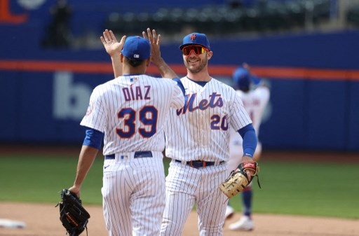 Pete Alonso #20 of the New York Mets and Edwin Diaz #39 celebrate. Al Bello/Getty Images/AFP