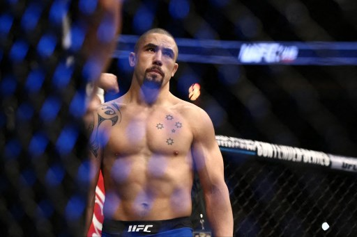 Robert Whittaker stands in the Octagon. Rey Del Rio/Getty Images/AFP