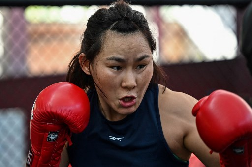 In this photo, Chinese mixed martial arts (MMA) fighter Yan Xiaonan attends a training session. Photo by Hector RETAMAL / AFP