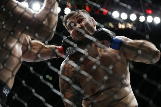 Augusto Sakai of Brazil is hit with a punch. Michael Reaves/Getty Images/AFP