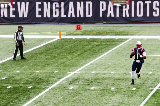 Cam Newton #1 of the New England Patriots throws the ball.  Adam Glanzman/Getty Images/AFP