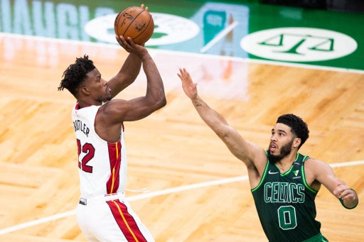 Jimmy Butler #22 of the Miami Heat shoots while defended. Kathryn Riley/Getty Images/AFP