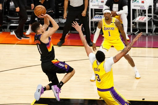 Devin Booker #1 of the Phoenix Suns attempts a shot over Anthony Davis #3 of the Los Angeles Lakers. Christian Petersen/Getty Images/AFP