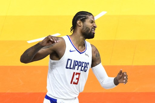 Paul George #13 of the Los Angeles Clippers reacts after missing a basket. Alex Goodlett/Getty Images/AFP