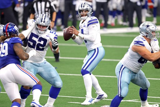 Dak Prescott #4 of the Dallas Cowboys looks to pass against the New York Giants. Tom Pennington/Getty Images/AFP