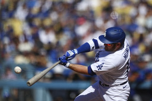 Max Muncy #13 of the Los Angeles Dodgers hits a double. Meg Oliphant/Getty Images/AFP