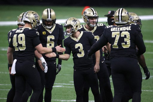 the New Orleans Saints celebrate their  second field goal against the Tampa Bay Buccaneers. Chris Graythen/Getty Images/AFP