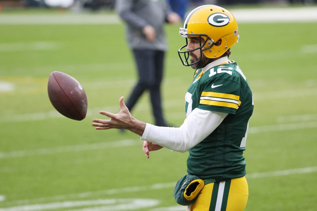 Aaron Rodgers #12 of the Green Bay Packers warms up. Dylan Buell/Getty Images/AFP