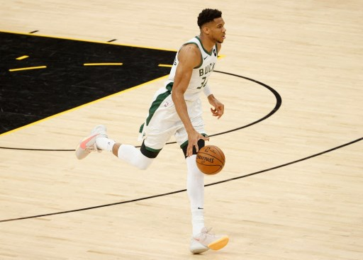 Giannis Antetokounmpo #34 of the Milwaukee Bucks handles the ball. Christian Petersen/Getty Images/AFP
