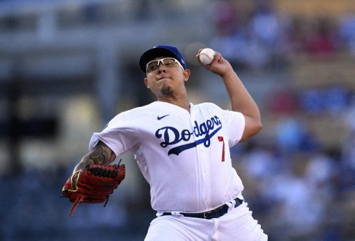 Julio Urias #7 of the Los Angeles Dodgers throws on August 7, 2021 in Los Angeles, California.   Kevork Djansezian/Getty Images/AFP
