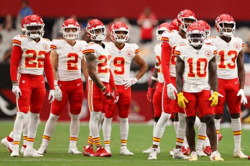 The Kansas City Chiefs warm up before the NFL preseason.Christian Petersen/Getty Images/AFP