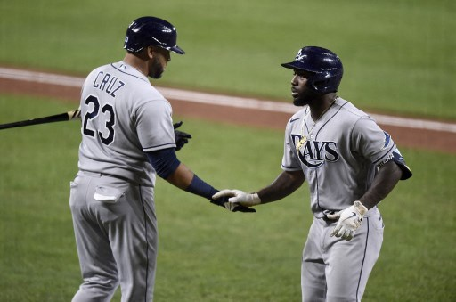 Randy Arozarena #56 of the Tampa Bay Rays celebrates with Nelson Cruz #23. Greg Fiume/Getty Images/AFP