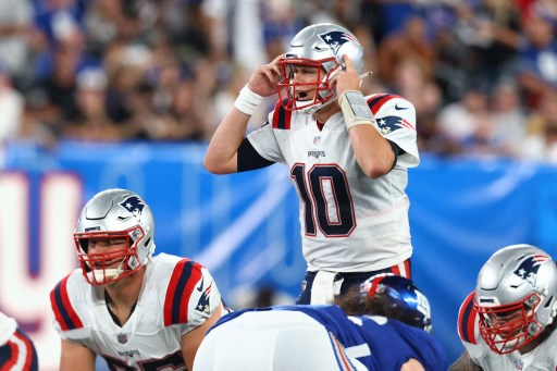 Mac Jones #10 of the New England Patriots looks to pass the ball against against the New York Giants on August 29, 2021. Mike Stobe/Getty Images/AFP