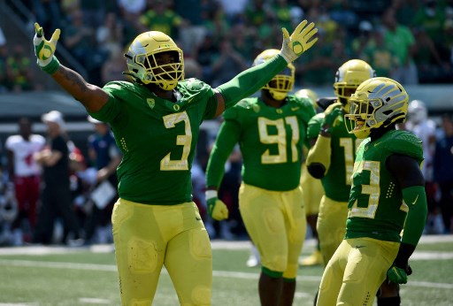 Defensive tackle Brandon Dorlus #3 of the Oregon Ducks reacts. Steve Dykes/Getty Images/AFP