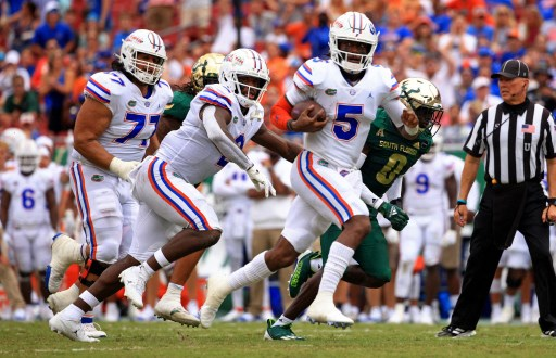 Emory Jones #5 of the Florida Gators rushes for a touchdown. Mike Ehrmann/Getty Images/AFP