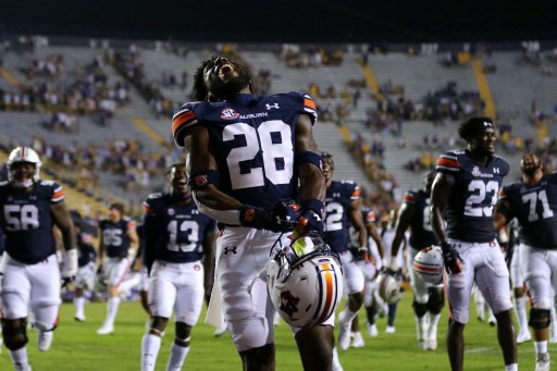 Devin Guice #28 of the Auburn Tigers celebrates.  Jonathan Bachman/Getty Images/AFP (Photo by Jonathan Bachman / GETTY IMAGES NORTH AMERICA / Getty Images via AFP)
